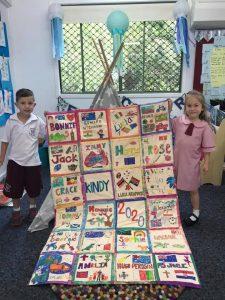 Children holding Kindy Quilt